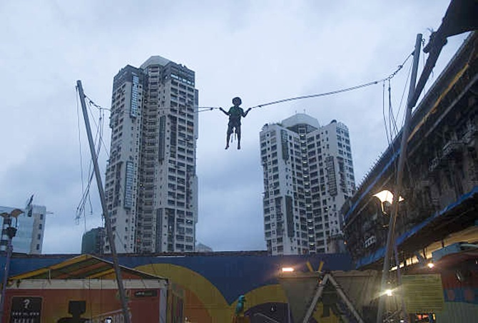 A boy plays on a giant trampoline in Mumbai.