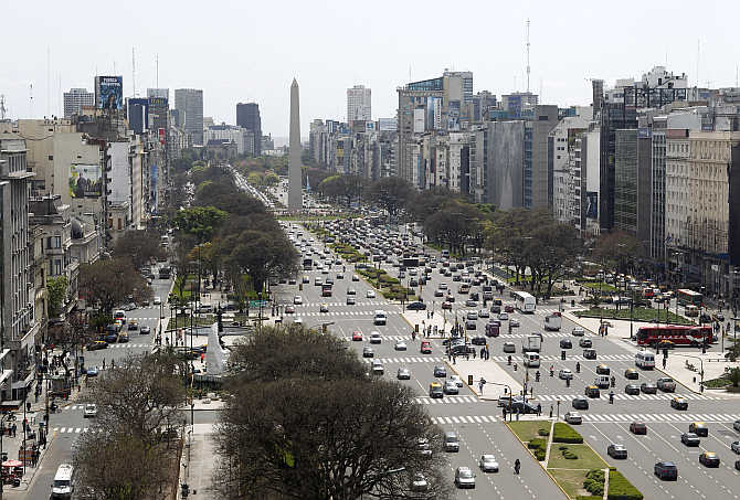 Overview of Buenos Aires' 9 de Julio Avenue with the Obelisk in the background in Buenos Aires, Argentina.