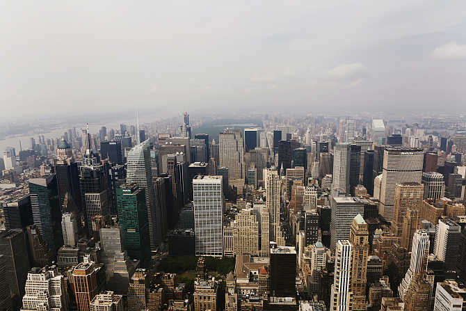 A view from the observation deck of the Empire State Building of midtown Manhattan, Rockefeller Center and Central Park in New York City.