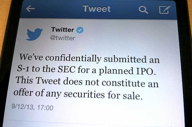 A tweet from Twitter announcing its initial public offering is shown in this photo illustration.