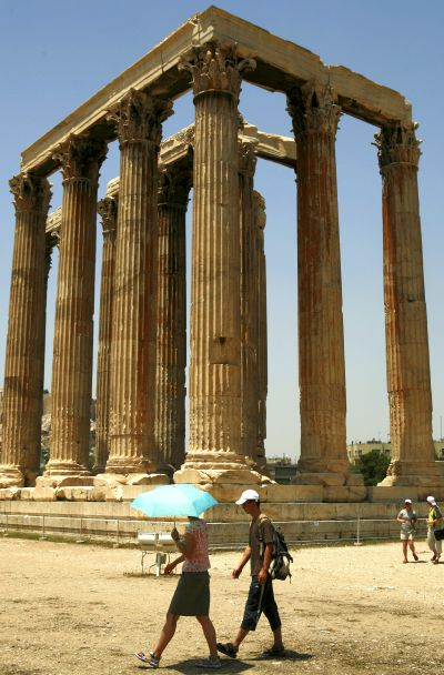 Tourists visit the temple of Olympian Zeus in Athens.