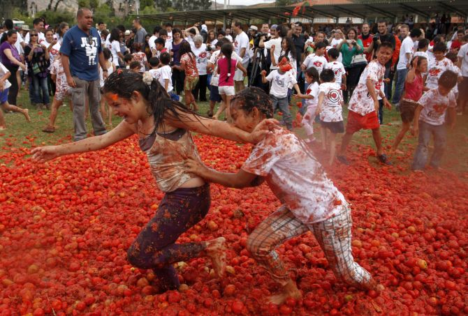 Revellers play with tomato pulp during the annual Tomatina (tomato fight) in Sutamarchan Province in Boyaca.