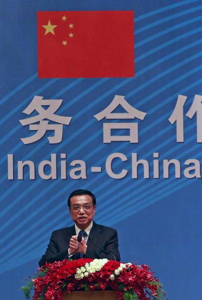 Chinese Premier Li Keqiang gestures as he addresses a gathering during a business summit in Mumbai.