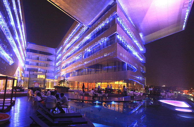 Aqua, a bar popular with the upwardly mobile in Hyderabad. The fact that Harper's Bazaar, Rolls-Royce and BMW are doing well in India is all wonderful, but symptomatic of a nation where the total wealth of its billionaires is almost 10 per cent of the national GDP, down from 22 per cent at the peak just prior to the global financial crisis, says Ram Kelkar