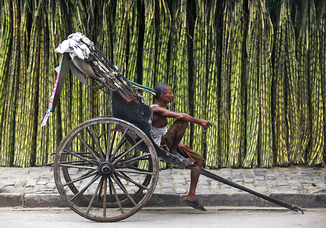 A hand-rickshaw puller waits for customers in Kolkata. If the common man does not see continuing improvement in quality of life after decades of rapid growth and happy talk of Shining India, there could be serious consequences, says Ram Kelkar