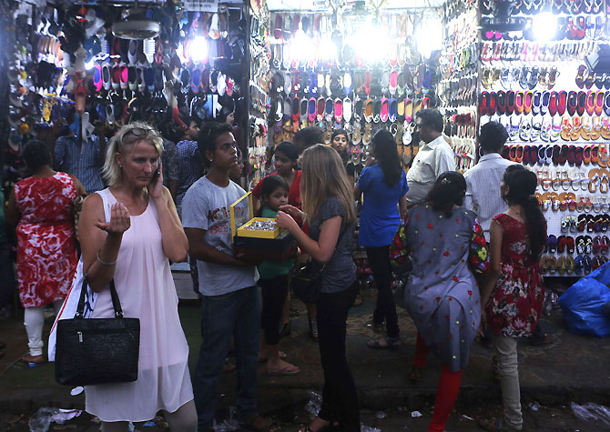 Shoppers at a market in Mumbai. India should exit Hubristan and stop patting itself on its back for 5 years of rapid growth, says Ram Kelkar