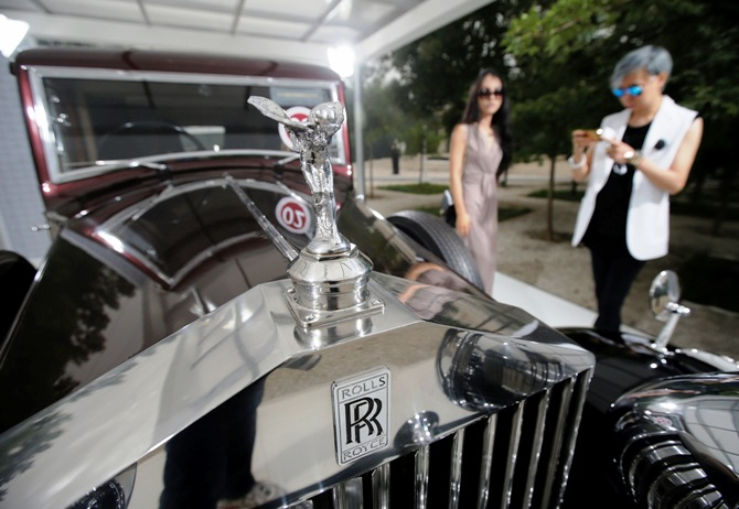 Visitors look around Rolls-Royce's vintage car during the Rolls-Royce's Concours d'Elegance event for celebrating its 10 years of business in China.
