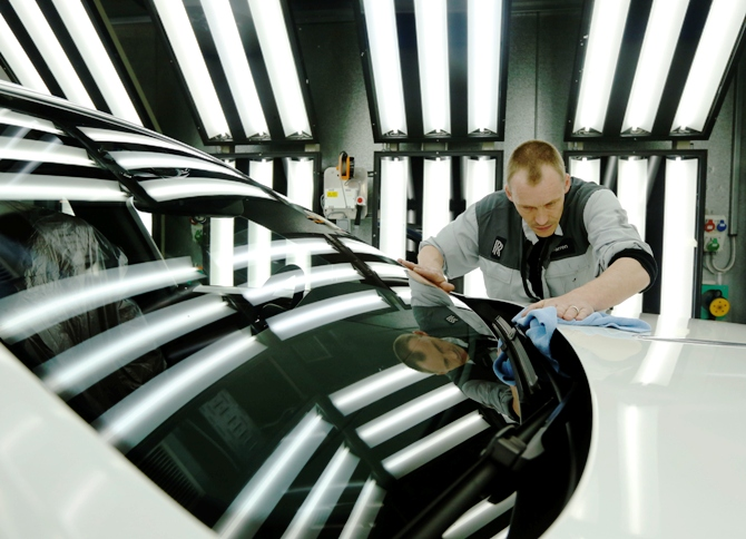 Employee Darren Lowarson give a Rolls Royce Ghost its final finish polish at the Rolls Royce Motor Cars factory at Goodwood near Chichester in southern England.