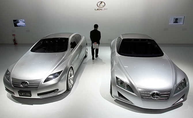 Toyota's Lexus brand concept vehicles LF-S, left, and LF-C, right, on display in Tokyo, Japan.