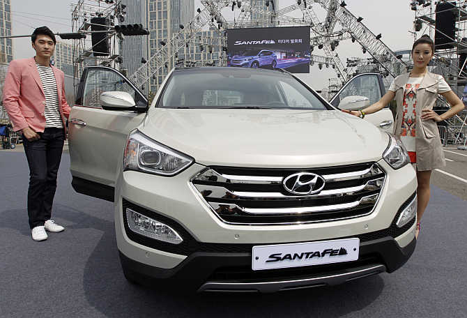 Models pose with Hyundai's Santa Fe in Incheon, west of Seoul, South Korea.