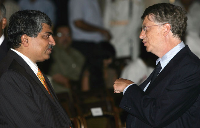Nandan Nilekani (left) with Bill Gates. Will he, won't he?