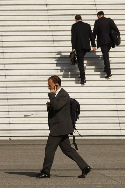 A businessman speaks on his phone near the steps at the Arche de la Defense, the financial and business district west of Paris.