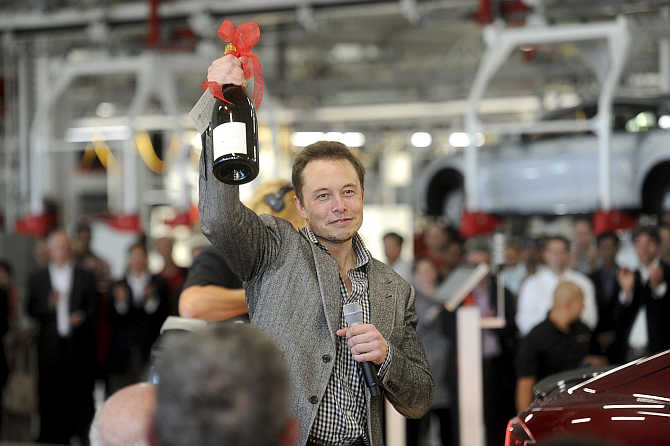 Elon Musk celebrates at his company's factory in Fremont, California.