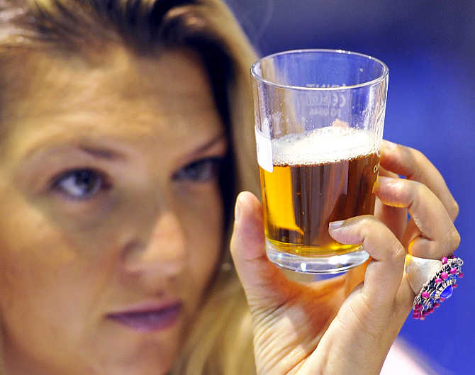 A judge views samples of real ale at the Great British Beer Festival at Earl's Court in west London.