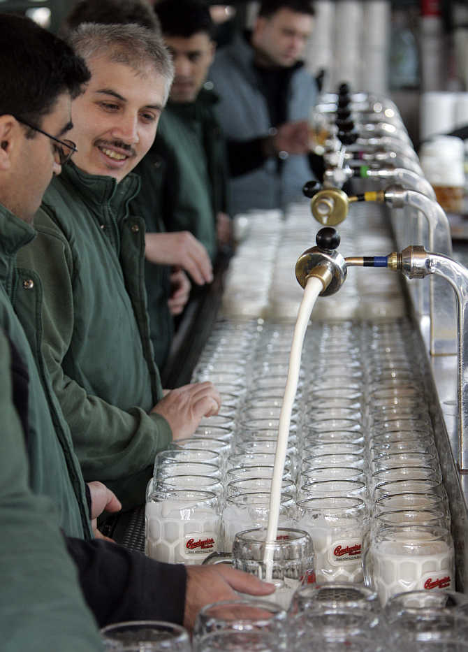 Beer is tapped at the opening of Vienna's Schweitzerhaus, a traditional beer garden at an amusement park, in Austria.