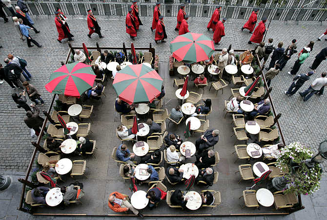 Tourists sit on a terrace during the annual Belgian beer weekend at the Grand Place in Brussels, Belgium.