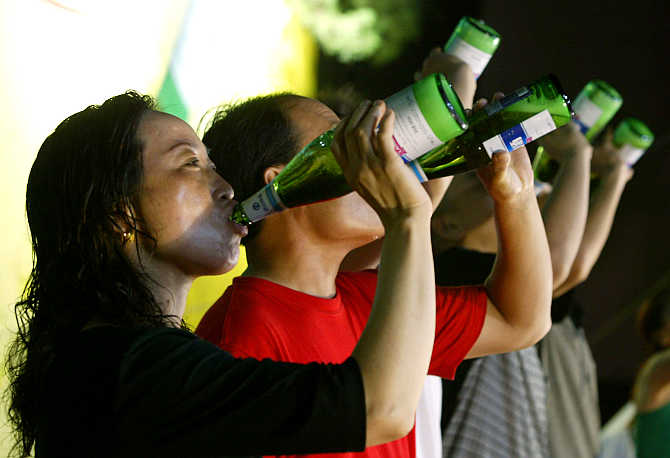 Contestants chug beer during a drinking competition in Jinan, capital of China's eastern Shandong province.