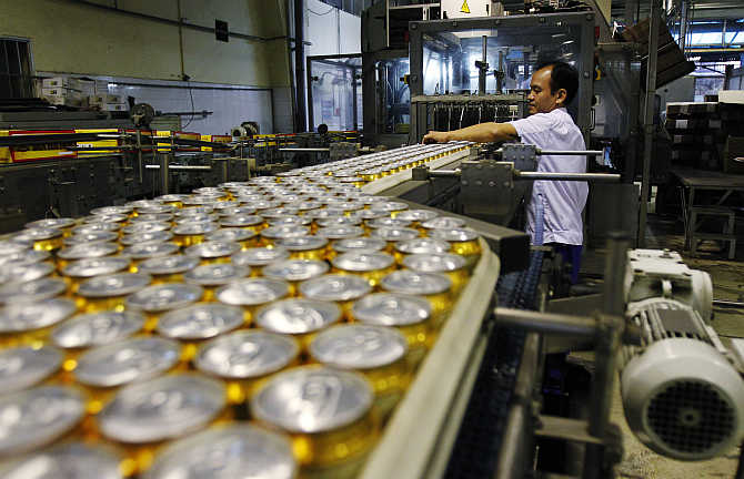 Canned beer move along a production line in Hanoi, Vietnam.