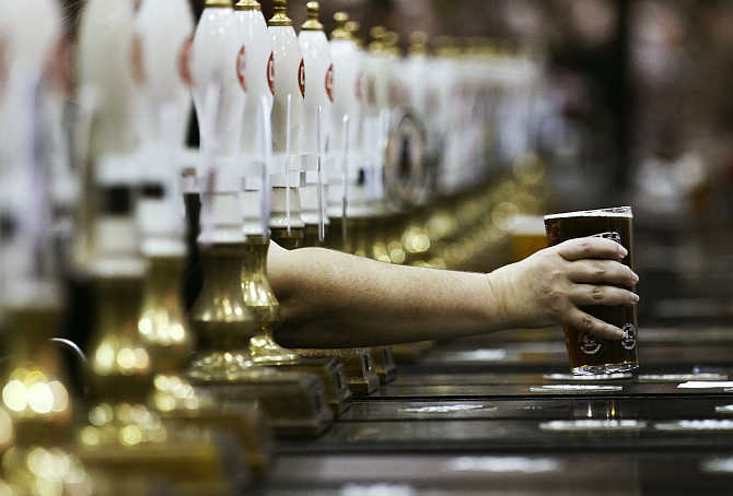 A pint of beer is served through rows of beer pumps at the Campaign For Real Ale Great British Beer Festival at Earls Court in London.