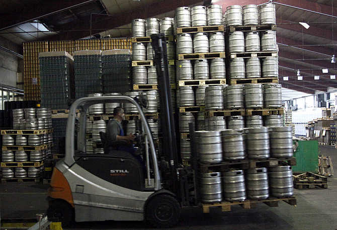 An employee drives a fork lift with beer barrels in the Ottakringer brewery in Vienna, Austria.