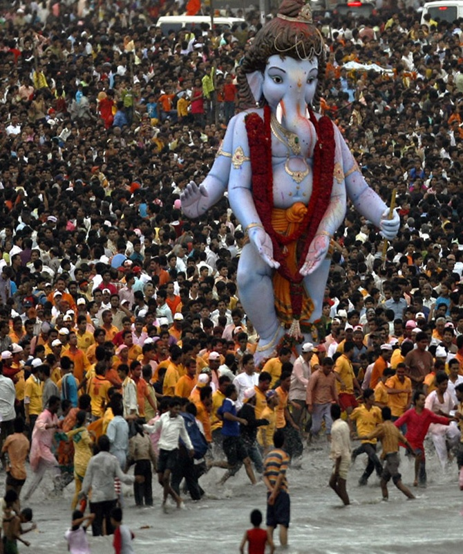 Devotees carry a statue of the Hindu elephant god Ganesh for immersion in the sea, on the last day of 'Ganesh Chaturthi', in Mumbai.