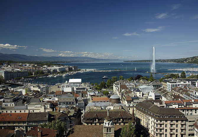 An overview picture shows Jet d'Eau (water fountain) and Lake Leman from St-Pierre Cathedrale in Geneva, Switzerland.