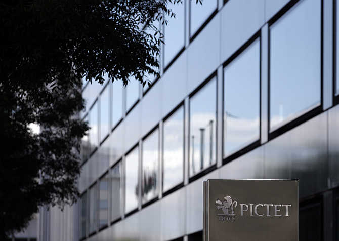 A sign bearing the logo of family owned private bank Pictet is pictured at the company headquarters in Geneva, Switzerland.