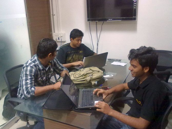 Employees working in Autowale office.