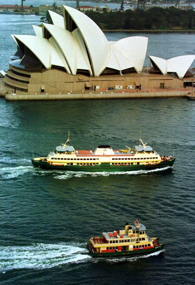 Two ferries pass the Sydney Opera House.