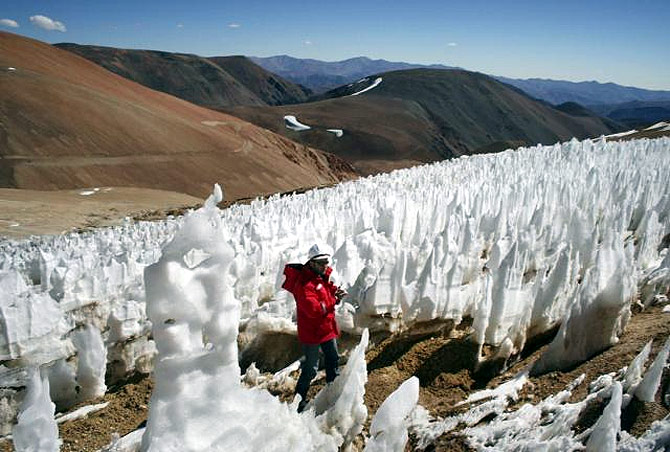 A man walks by the EK Toro II glacier in the on the Chilean side of the border district between Chile's Huasco and Argentina's San Jauan Province.