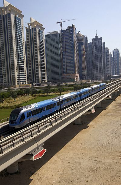 A Dubai Metro train runs past Sheikh Zayed road in Dubai.