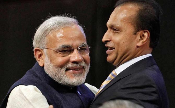 Narendra Modi hugs Anil Ambani.