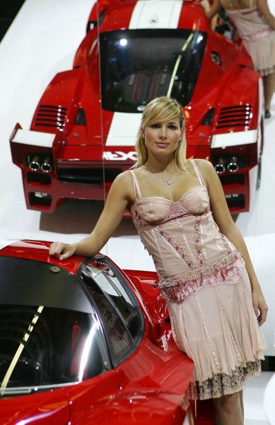 A model poses with the new Ferrari FXX at the Bologna Motorshow.