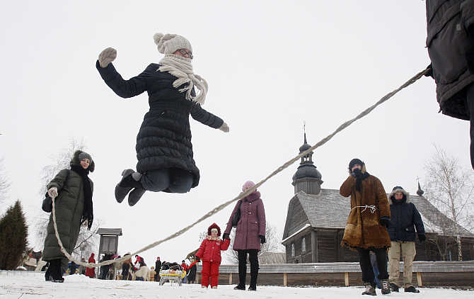 People celebrate Maslenitsa, or Pancake Week, in the village of Ozertso, outside Minsk, Belarus.