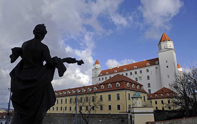'Welcome' statue in front of Bratislava castle in Bratislava, Slovakia.