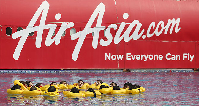 The logo of Malaysia's low-cost airline AirAsia Berhad is pictured on a structure as its staff undergo training at its academy in Sepang outside Kuala Lumpur.