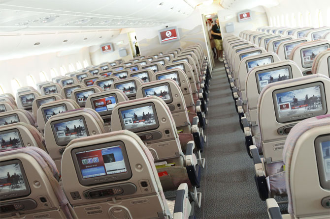 A picture shows the economy class section of an Airbus A380 passenger plane of Emirates Airline at the ILA International Air Show in Schoenefeld outside Berlin.