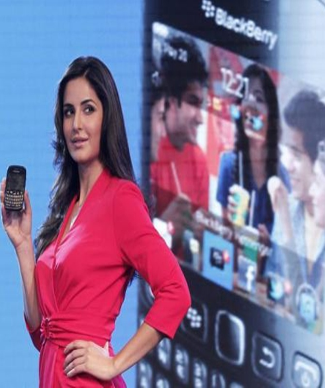 Bollywood actress Katrina Kaif poses with the BlackBerry Curve 9220 smartphone in New Delhi.