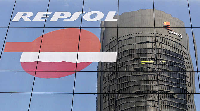 Sacyr Vallehermoso Tower is reflected on the Repsol office building in Madrid, Spain.
