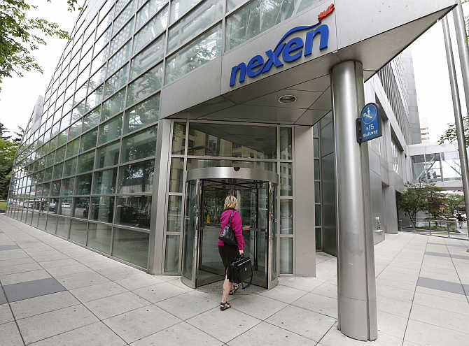 A woman walks into the Nexen building in downtown Calgary, Alberta, Canada.