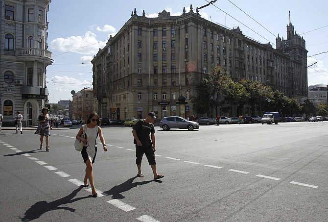 People cross a street in central Kharkiv, Ukraine.