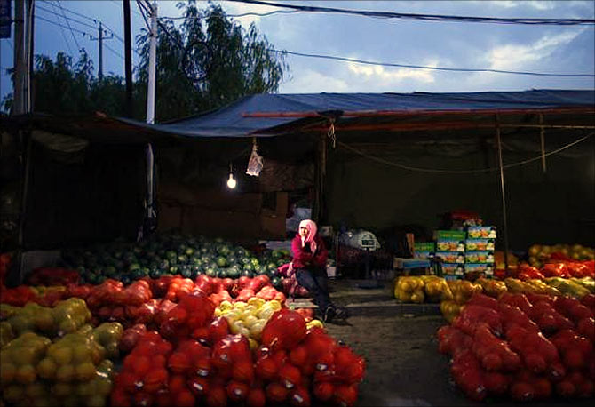A vendor sits at a local market in Minqin town, Gansu province.