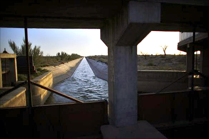 An irrigation canal is seen on the outskirts of Minqin town, Gansu province.