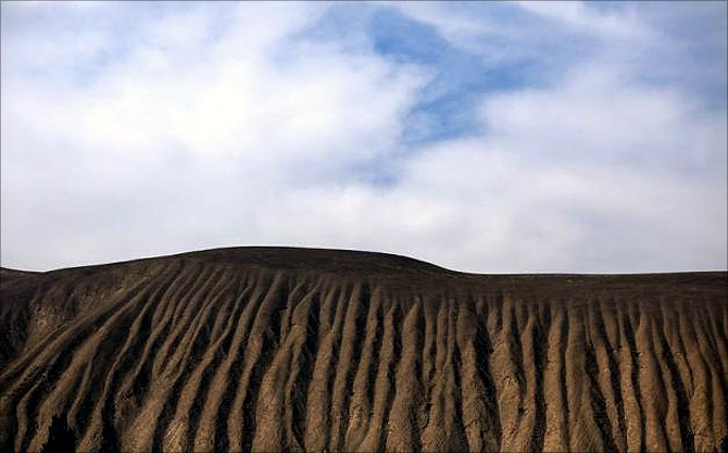 A dry slope is seen near the Shiyang river on the outskirts of Wuwei, Gansu province.