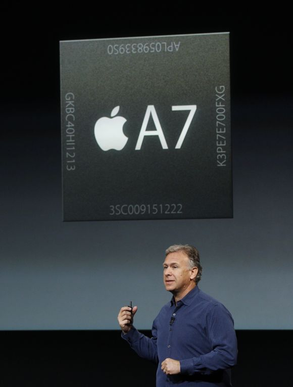 Phil Schiller, senior vice president of worldwide marketing for Apple Inc talks about the A7 chip during Apple Inc's media event in Cupertino, California.