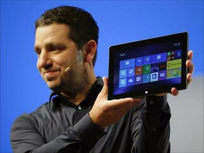 Panos Panay, Microsoft Surface general manager, holds up the Microsoft Surface Pro 2 during the launch of their Surface 2 tablets in New York.