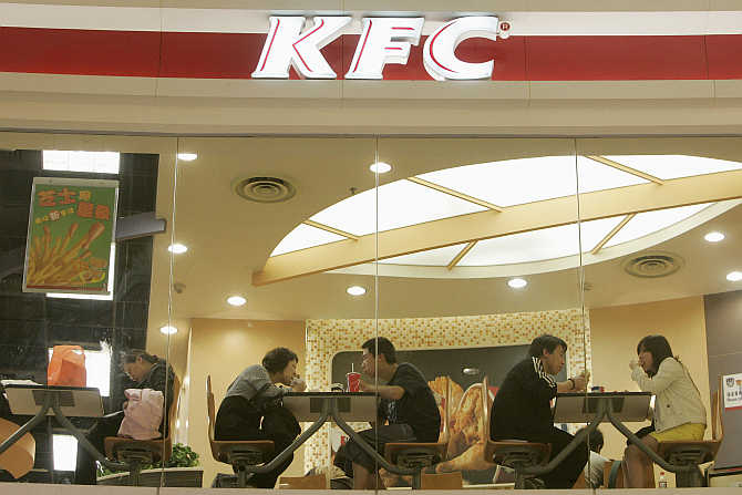 People dine at a Kentucky Fried Chicken outlet in Shanghai.