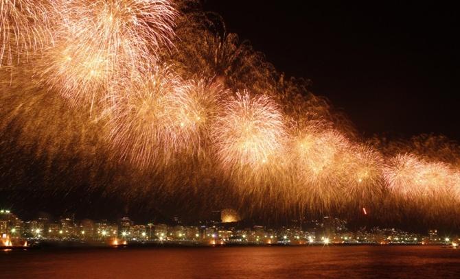 Fireworks explode above Copacabana beach in Rio de Janeiro, Brazil