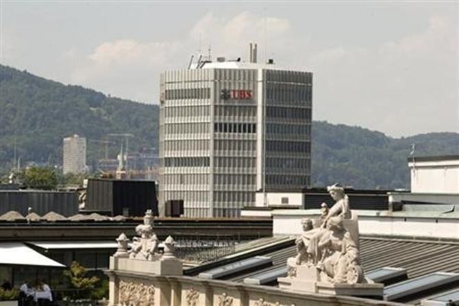 Logo of Switzerland's biggest bank UBS is seen at an office building in Zurich.