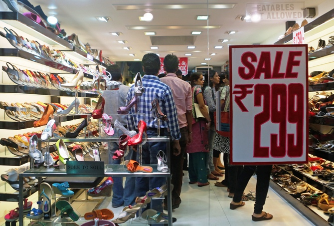 People shop inside a shoe store on a street in Mumbai.